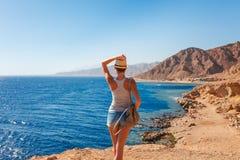 Free Tourist Woman In Dahab Near Blue Hole At The Red Sea Coast. Famous Travel Destionation In Desert. Sharm El Sheik, Dahab, Sinai Stock Photo - 147857460