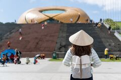 Free Tourist Woman Is Wearing Non La Vietnamese Tradition Hat And Enjoy Sightseeing In Lam Vien Square, Dalat City Vietnam Stock Photo - 173195880