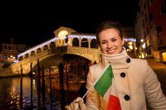Tourist woman with Italian flag spending Christmas in Venice Stock Photo