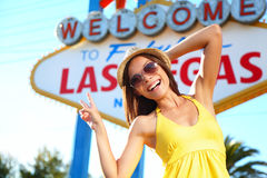 Tourist woman in Las Vegas sign posing happy stock photo
