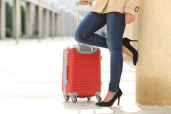 Tourist woman legs waiting with a suit case in an airport Stock Images