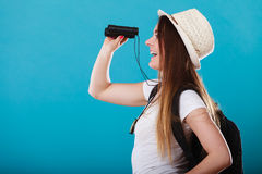 Tourist woman looking through binoculars on blue Royalty Free Stock Photo