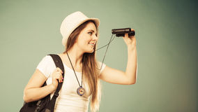 Tourist woman looking through binoculars Royalty Free Stock Images