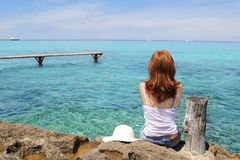 Tourist woman looking Formentera turquoise sea Royalty Free Stock Images