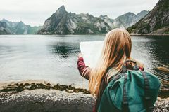 Tourist woman with map sightseeing Lofoten islands. In Norway Travel lifestyle concept adventure outdoor summer vacations Royalty Free Stock Images