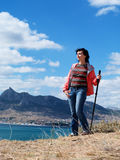 Tourist woman in mountains Stock Image