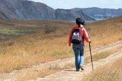 Tourist woman in mountains Royalty Free Stock Photo