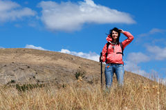 Tourist woman in mountains Stock Photography