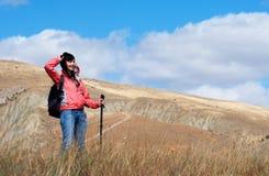 Tourist woman in mountains Stock Photos