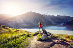 Tourist woman at the mountains Stock Photography