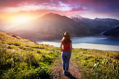 Tourist woman at the mountains at sunrise Royalty Free Stock Photography