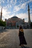 Tourist woman near Hagia Sophia mosque landmark Turkey Istanbul Royalty Free Stock Images