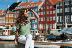 Tourist woman at the Nyhavn harbor pier Copenhagen, Denmark. Royalty Free Stock Images
