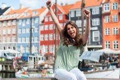 Tourist woman at the Nyhavn harbor pier Copenhagen, Denmark. Stock Photos