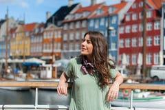 Tourist woman at the Nyhavn harbor pier Copenhagen, Denmark. Stock Images