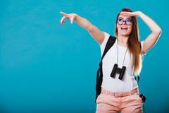 Tourist woman pointing copyspace with finger Royalty Free Stock Image