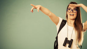 Tourist woman pointing copyspace with finger Stock Photography