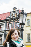 Tourist woman posing with building and old lantern in Main squar Stock Image