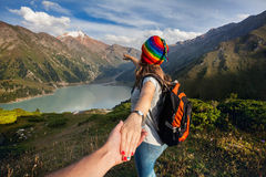 Tourist woman in rainbow hat at the mountains Stock Photos
