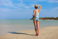 Tourist woman at the Red Sea coast and mangroves in the Ras Mohammed National Park. Famous travel destionation in desert. Sharm el. Sheik, Sinai Peninsula royalty free stock images
