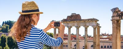 Tourist woman in Rome taking photo with digital camera Stock Photography