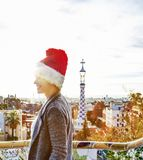 Tourist woman in Santa hat at Guell Park looking into distance Stock Photos