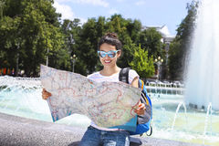 Tourist woman searching direction on location map Royalty Free Stock Image