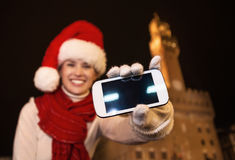 Tourist woman showing smartphone`s blank screen, Italy. Closeup. Royalty Free Stock Image