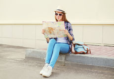 Tourist woman sightseeing city with paper map Stock Photos