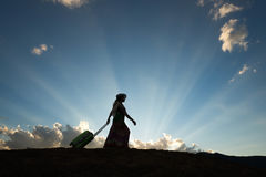 Tourist woman silhouette. Tourist woman travel with luggage beautiful sunset royalty free stock images