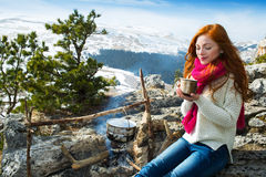 Tourist woman sits at the camp in  forest and mountains Stock Image