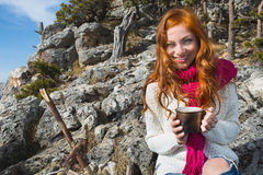 Tourist woman sits at the camp in  forest and mountains Stock Photography