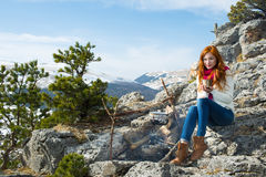 Tourist woman sits at the camp in  forest and mountains Stock Photo