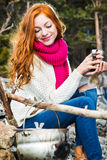 Tourist woman sits at the camp in  forest and mountains Royalty Free Stock Photo