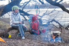 Tourist woman sits at the camp in the forest Stock Photography