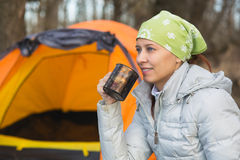 Tourist woman sits at the camp in the forest Royalty Free Stock Images