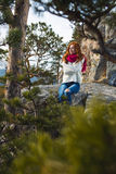 Tourist woman sits at the camp in the forest Royalty Free Stock Image