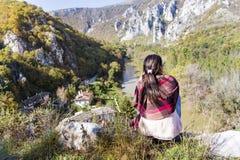 Tourist woman sitting on the top of the  autumn mountain,enjoying the view Stock Photo