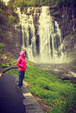 Tourist woman by Skjervsfossen Waterfall - Norway Royalty Free Stock Images