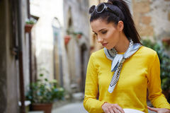 Tourist woman in a small Italian town. Royalty Free Stock Photo