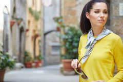 Tourist woman in a small Italian town. Royalty Free Stock Photography