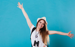 Tourist woman spreading hands with joy, Stock Photo