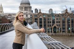 Free Tourist Woman Stays In Front Of The St. Pauls Cathedral In London, UK Stock Photo - 162865570