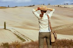 Tourist woman on summer Tuscany trail looking into distance royalty free stock photos