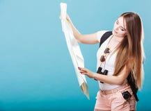 Tourist woman sunglasses read map on blue Stock Image