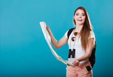 Tourist woman sunglasses read map on blue Royalty Free Stock Image