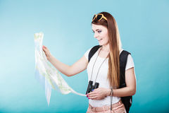 Tourist woman sunglasses read map on blue Stock Images