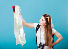 Tourist woman sunglasses read map on blue Royalty Free Stock Images