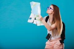 Tourist woman sunglasses read map on blue Royalty Free Stock Photo
