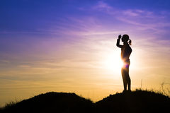Tourist woman at sunset. Royalty Free Stock Photos